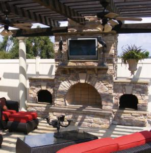 An outdoor space with TV and fireplace...you could roast sausages in that thing!!
