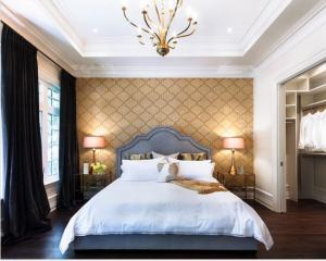 The bed already creates the 'accent wall',  emphasize it with a wallper pattern which compliments your décor.