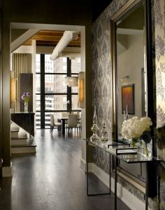 An Entry hall can be accented with a dramatic wallpaper to add personality to the space.