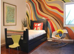 Kids rooms are a natural fit for 'accent walls', you can change them a few times between infant and teenage years, allowing them to express themselves accordingly.