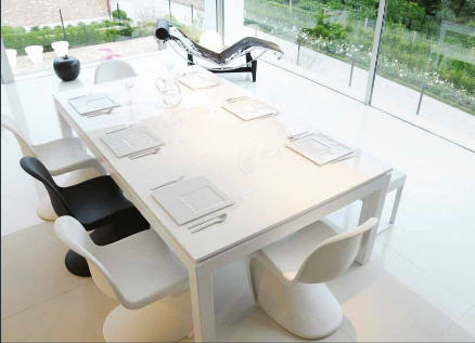 You may think that this is simply a fabulous white parsons dining table...but....